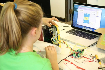 Student disects her robot to make adjustments